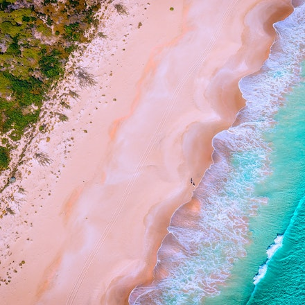 Cape Naturaliste - People on a morning walk on the beach. Shot from a light plane.