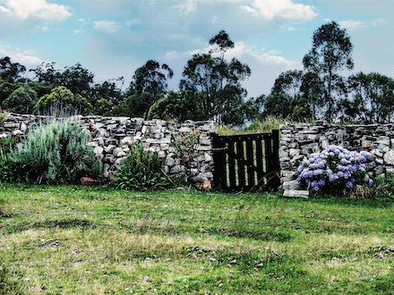 The Old Gate - Garden gate set in a stone wall. The materials taken from the property.