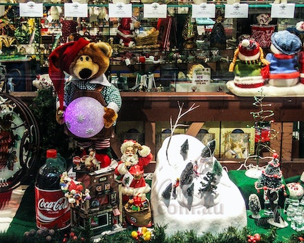 A Coke for Santa - Looking through a shop window at all the sights of Christmas. Even a bottle of coke for Santa.