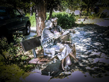 In the Shade - Elderly couple sharing a quiet moment in a Carmel park. Lifelike bronze statue.