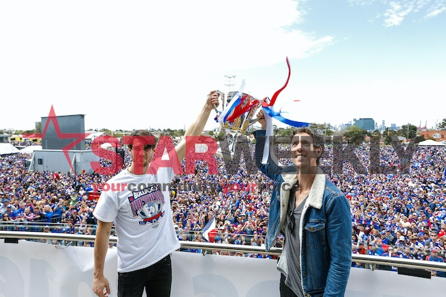 Family Day-12-1 - Easton Wood and Robert Murphy hoist the AFL Cup in front of thousands of Bulldogs fans at the Western Bulldogs family day at Whitten...