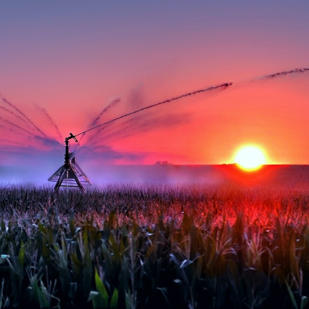 Pivot  7.28.2014.6 - Pivot. Taken during an August sunset south of Cortland Nebraska, this particular image won the Purchase Award at the Prairie Winds...