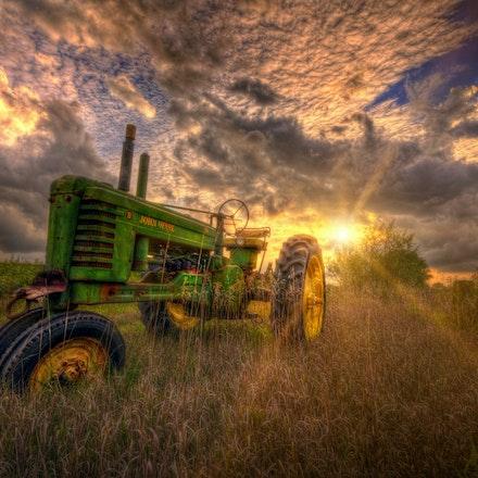 So Pretty 9.7.2016.11 - So Pretty. A soft glow from the setting Nebraska sun drapes over an old John Deere tractor. Lancaster County, NE. #farm #johndeere...